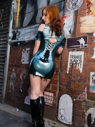 A world-renowed Manchester Mistress, Lola Ruin poses in a tight latex dress in Manchester City Centre