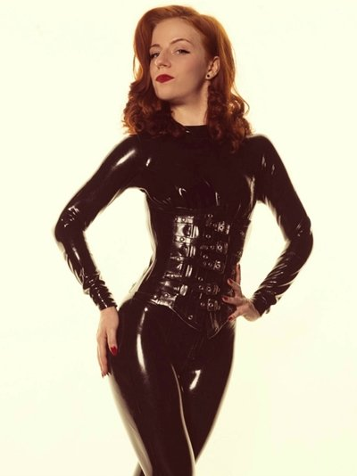 The best Mistress in Manchester, Lola Ruin is dressed head to toe in tight black latex catsuit and corset